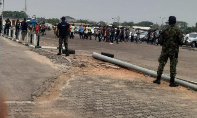 Protest: Security operatives bar youths from harrasing Oshiomhole